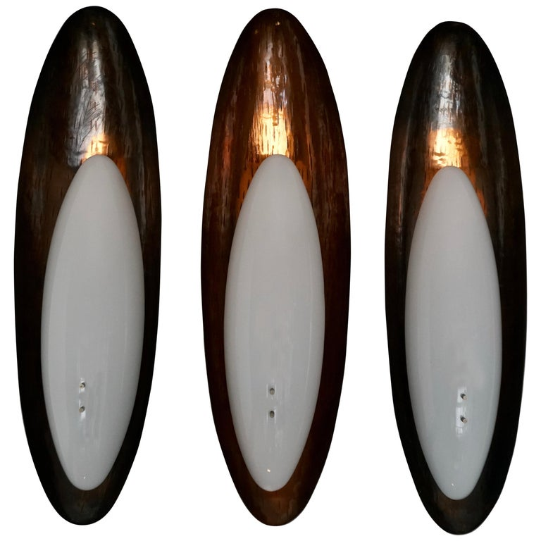 Three Hammered Copper Sconces by Reggiani For Sale