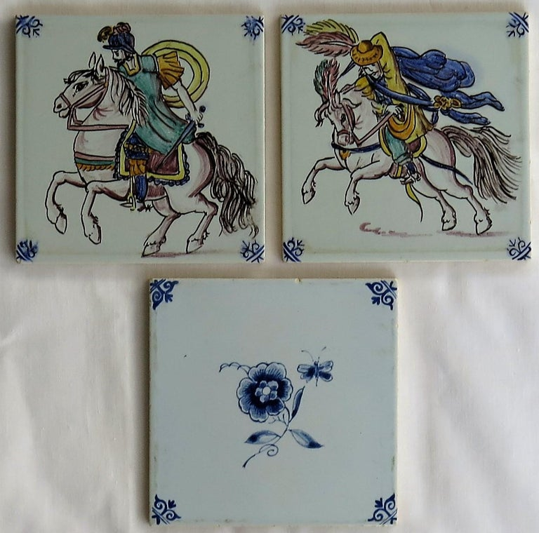 These are three attractive, hand painted, Dutch (Netherlands), delft ceramic wall tiles, dating to the early / mid-20th century, circa 1950s  All tiles are nominally 5 inches square and 5/16 inches thick.   The tiles all look to be hand painted,