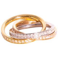 Three Interlocking Diamond and Three-Tone 18 Carat Gold Rings