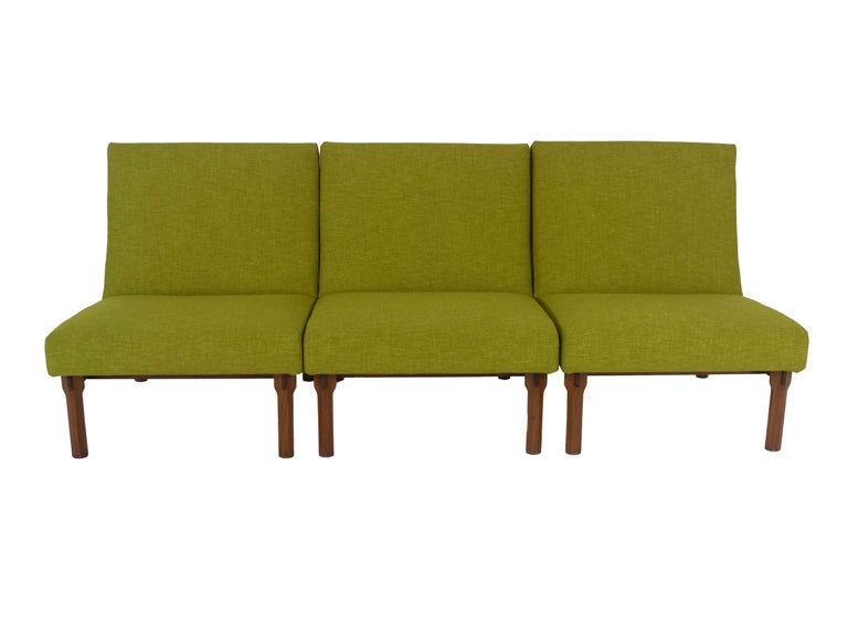 Three Italian Modern Ico Parisi chairs in walnut Model 869 were made for Cassina in Italy in the 1960s. These chairs can also feature as a sofa when put together. They are newly upholstered in green fabric (see reference picture). The details of the