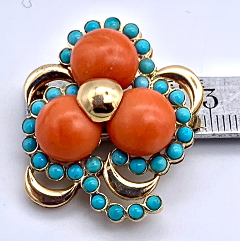 Wonderful chunky brooch in the shape of a three leaf clover made out of 14k gold, button coral and turquoise.