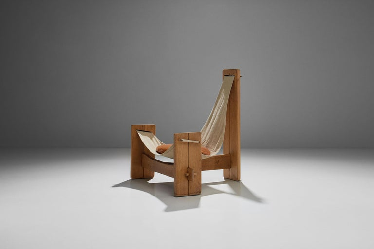This wood framed tripod sling chair with original canvas upholstery is one of a kind. It is an elemental composition with every part being essential to its structure. Held together entirely with tension, the structure consists of one long and two