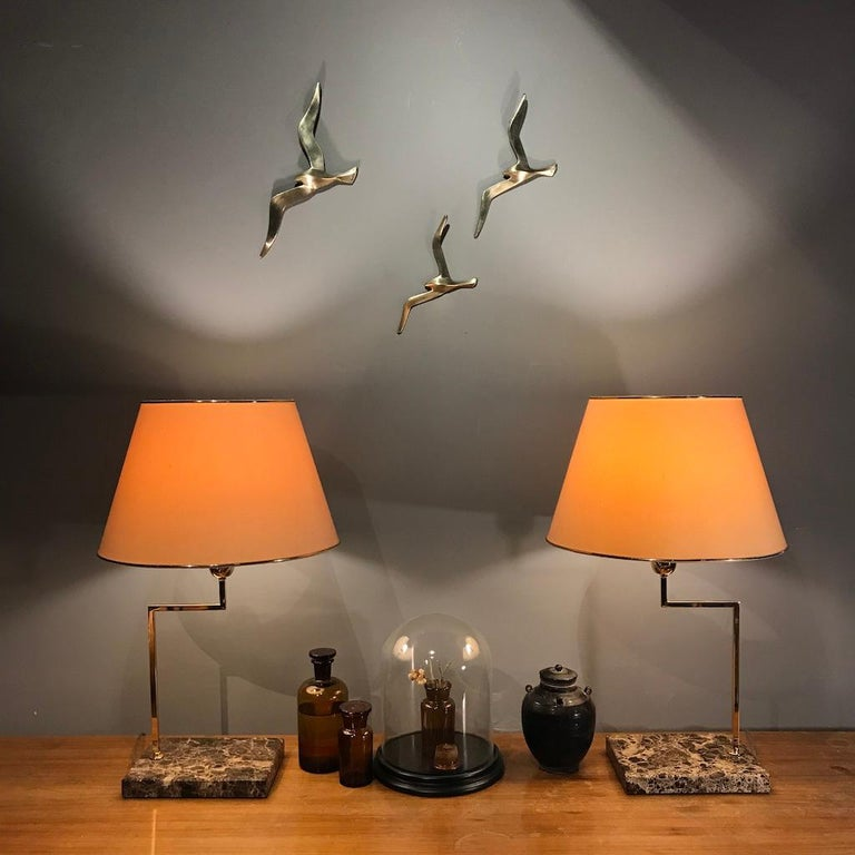 Three beautiful Austrian midcentury solid brass wall-mounted bird sculptures from 1950s. They are in the style of Auböck and competed with Auböck in their time. They are made of matt polished solid brass.