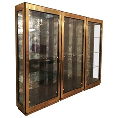 Three Modern Black Lacquered Brass Curio Display Cabinets by Mastercraft