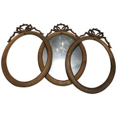 Three Oval French Louis XVI Style Frames with Ribbon Decoration