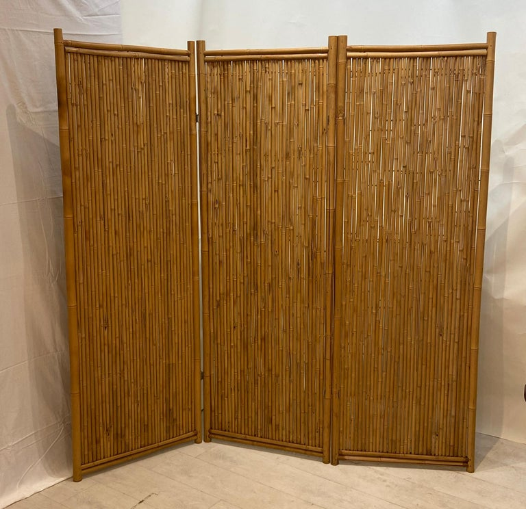 Large three panel bamboo screen. An older well constructed bamboo screen. Good even natural golden finish. Wire type hinges nice large screen