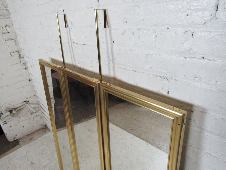 Brass frame door hanging mirror with three panels. Can open to three mirrors, or close to a single mirror. (Please confirm item location - NY or NJ - with dealer).