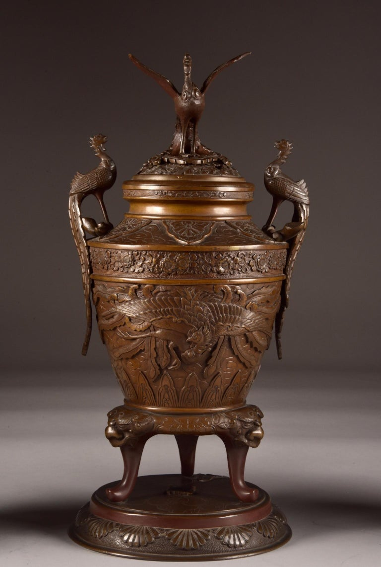 Impressive large high-quality and 3-piece bronze incense burner with Phoenix images and various wonderful floral reliefs and on three feet.  Japan - 19th century, in baluster-shape.  A wonderful set, rare, three-piece, beautiful and uniquely