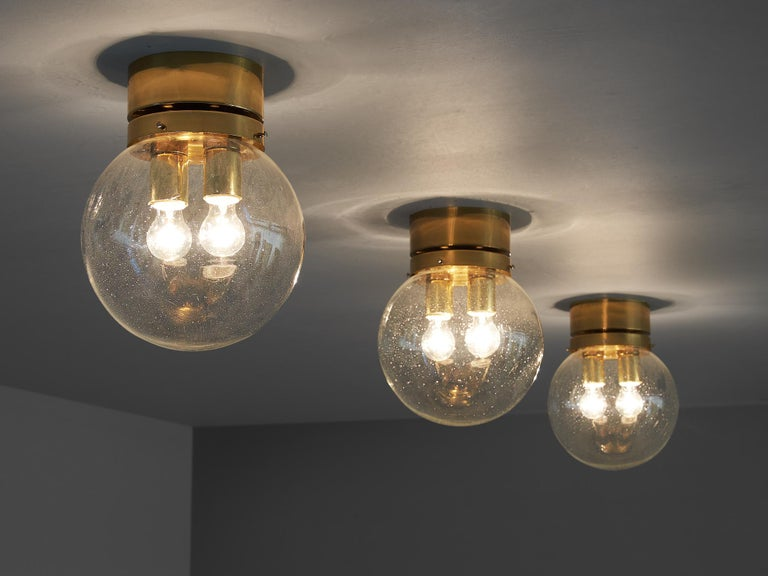 Mid-Century Modern Three Pendants in Brass and Glass For Sale