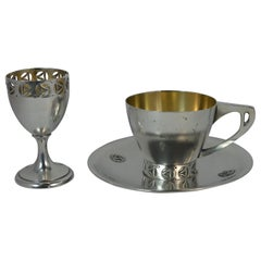 Three-Piece Arts & Crafts Solid Silver Cup Saucer and Egg Cup Set