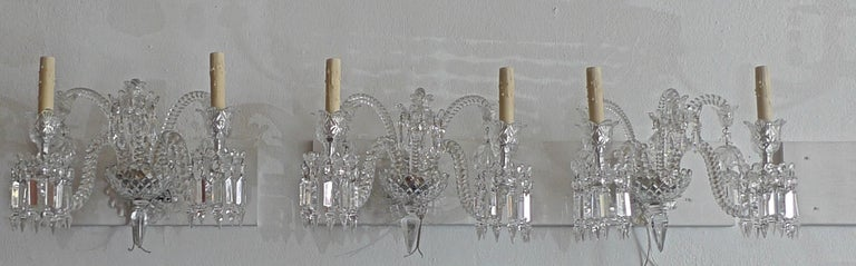 Three-piece French 1970s diamantes baccarat crystal electrified wall sconces.