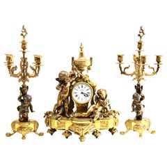 Three-Piece Gilt and Patinated Brass Clock Garniture Set