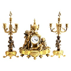 Three-Piece Gilt and Patinated Brass Clock Garniture Set
