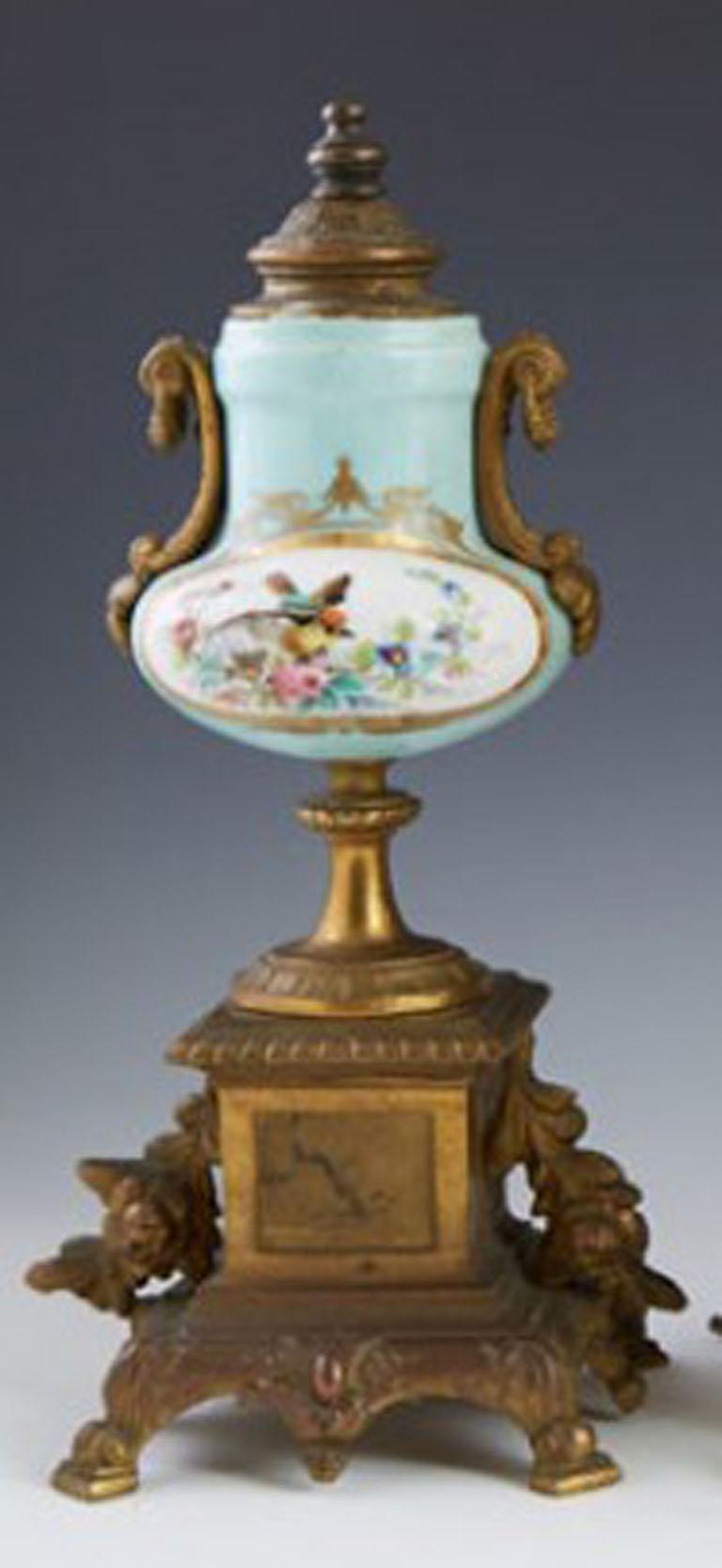 French Three-Piece Gilt Porcelain Clock Set For Sale