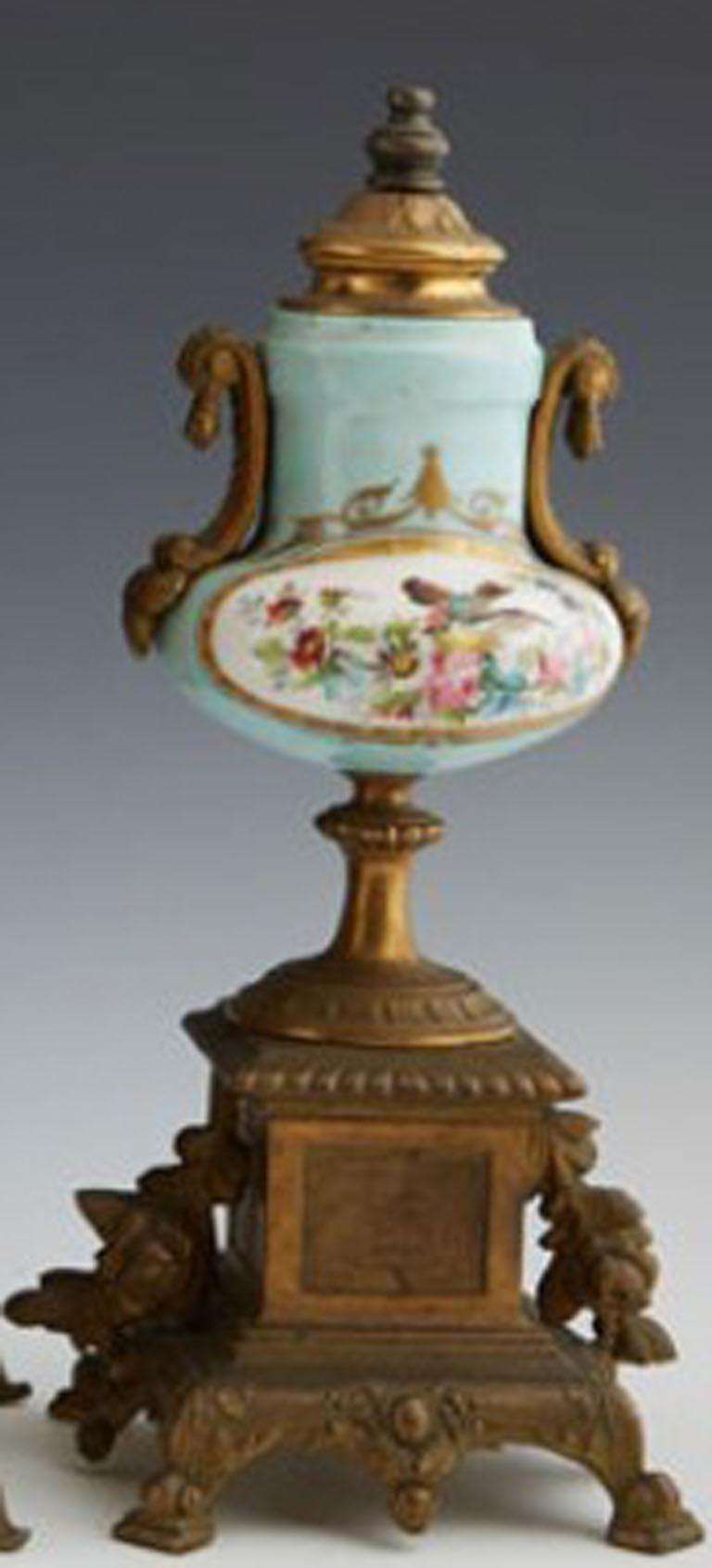 Painted Three-Piece Gilt Porcelain Clock Set For Sale
