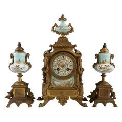 Three-Piece Gilt Porcelain Clock Set