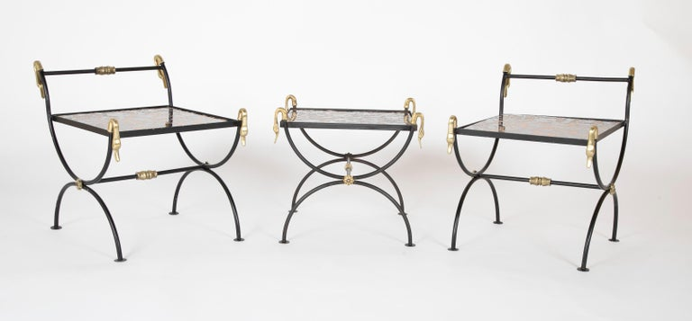 1930s three piece iron and brass coffee table with Versace insets/tops. Can be used together as one long coffee table or used individually as side tables.  Measures: 22.5