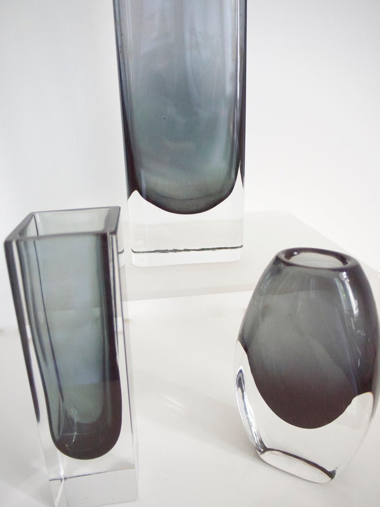 Vintage three piece collection Scandinavian Modern  Smoked Glass from Gunnar Anders for Lindshammer and Kaj Franck for Nuutajarvi  Measures: Large block vase  Height 21 cms, width 7 cms, depth 4 cms Weight 0.706 kgs  Small black block vase Height 14