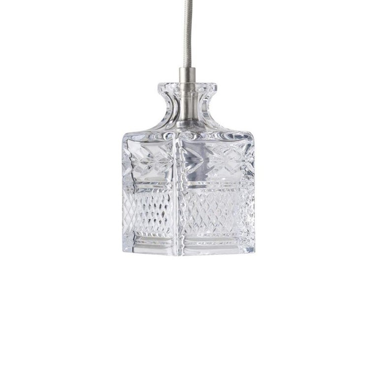 Silver linen cord accented mouth blown etched crystal canopy suspension lamps, composed in group set of 3.