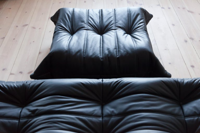 Three-piece togo set, design by Michel Ducaroy, manufactured by Ligne Roset this Togo living room set was designed by Michel Ducaroy in 1974 and was manufactured by Ligne Roset in France. It has been reupholstered in black high quality leather, and