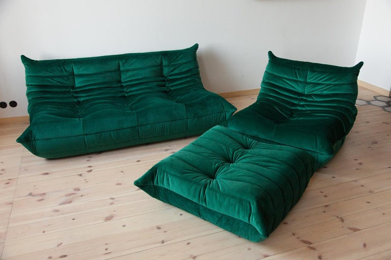 Three-piece Togo set, design by Michel Ducaroy, manufactured by Ligne Roset this Togo living room set was designed by Michel Ducaroy in 1974 and was manufactured by Ligne Roset in France. It has been reupholstered in bottle green high quality