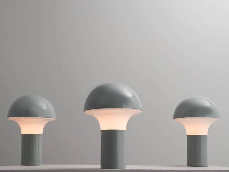 Set of three table lamps, in glass and metal, Italy, 1970s.  This is a set of three frivolous grey almost blue mushroom shaped table lamps. These lights consist of a white coated metal base with an opaline glass shade. Due their form and color