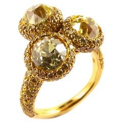 Three Round Yellow Diamonds 3.10 Carat Total Mounted in 18 Karat Yellow Gold