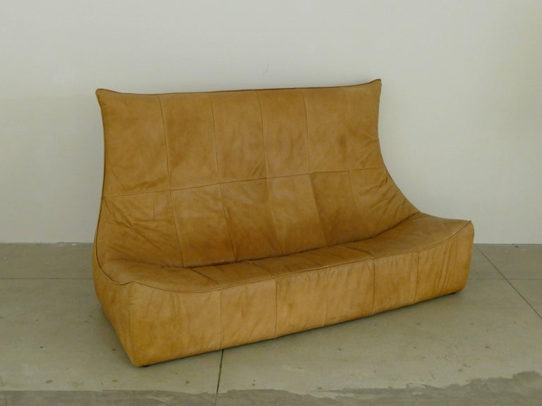 Original and authentic leather sofa by the Dutch designer Gerard van den Berg. Beautiful patina with no stains or marks on the leather. Stylish, comfortable and highly sought out piece of art or furniture. Sofa is in our showroom in the NY Design