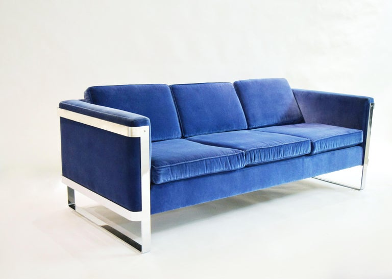 Pace Collection three-seat sofa with a solid, polished steel frame and six re-upholstered cushions in blue velvet. Arm height measures 25.5