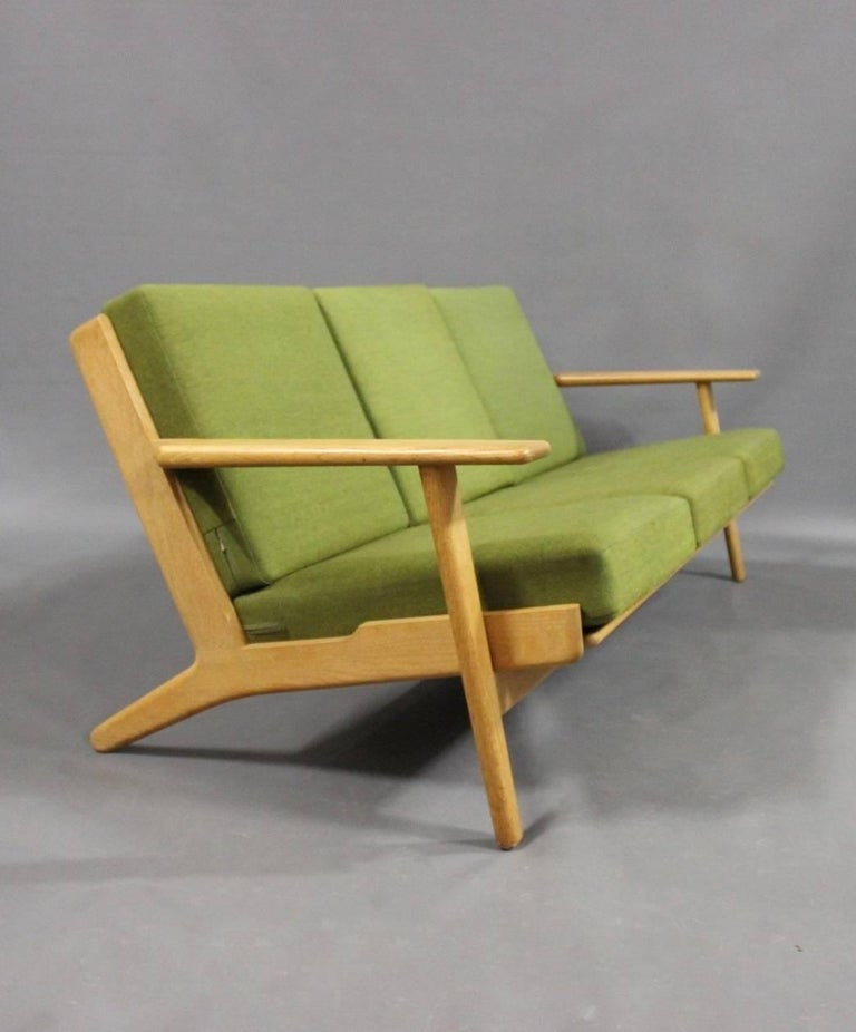 Three-seat sofa, model GE290, in oak and green Hallingdal wool. Designed by Hans J. Wegner in 1953 and manufactured by GETAMA in the 1960s.