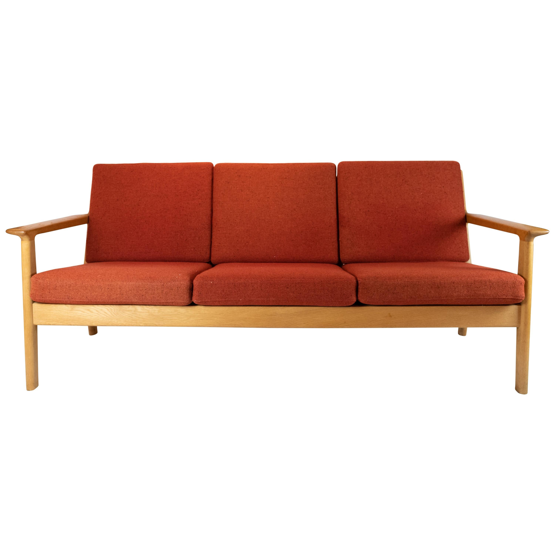 Three-Seat Sofa of Oak and Red Wool Fabric by Hans J. Wegner and GETAMA