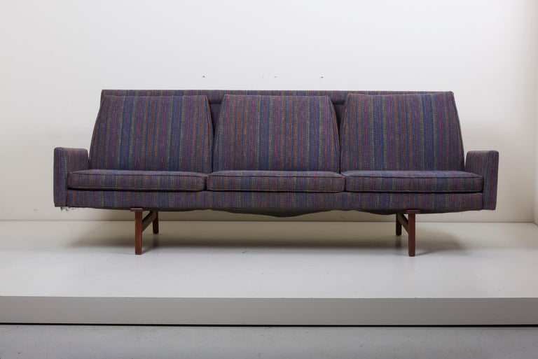 This Jens Risom sofa for Risom Design Inc. is in good condition. The solid walnut frame has been oiled and is in vintage condition with normal wear with age (slight imperfections). The sofa is beautiful from every angle.