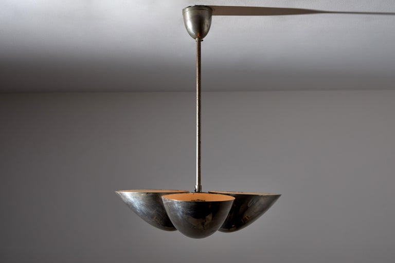 Three-shade Bauhaus chandelier by Zukov. Manufactured in Czech republic circa 1930s. Nickel plated brass. Original canopy. Rewired for US junction boxes. Takes three E27 60w maximum bulbs. Bulbs included as a one time courtesy.