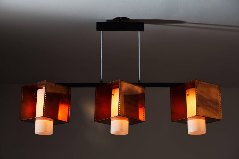 Rare three shade chandelier designed and manufactured by Stilnovo in Italy, circa 1960s. Copper-plated brass, brushed satin glass diffusers and enameled metal hardware. Rewired for US junction boxes. Each shade takes one E27 60w maximum bulb. Each