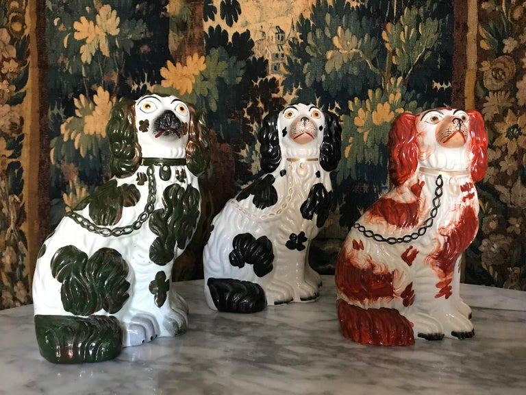 Three Staffordshire Dogs*; a very decorative set, each with different color spots and gilded details, as well as numbering beneath (two marked 2 & one dog marked 3;  see images)  One black and white dog, one dark green and white and one brownish-red