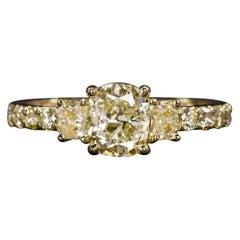 Three Stone 1.50 Carat Fancy Yellow Cushion Diamond 18 Carat Yellow Gold Ring