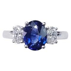 Three-Stone 18 Karat White Gold Oval Cut Blue Sapphire and Diamond Ring