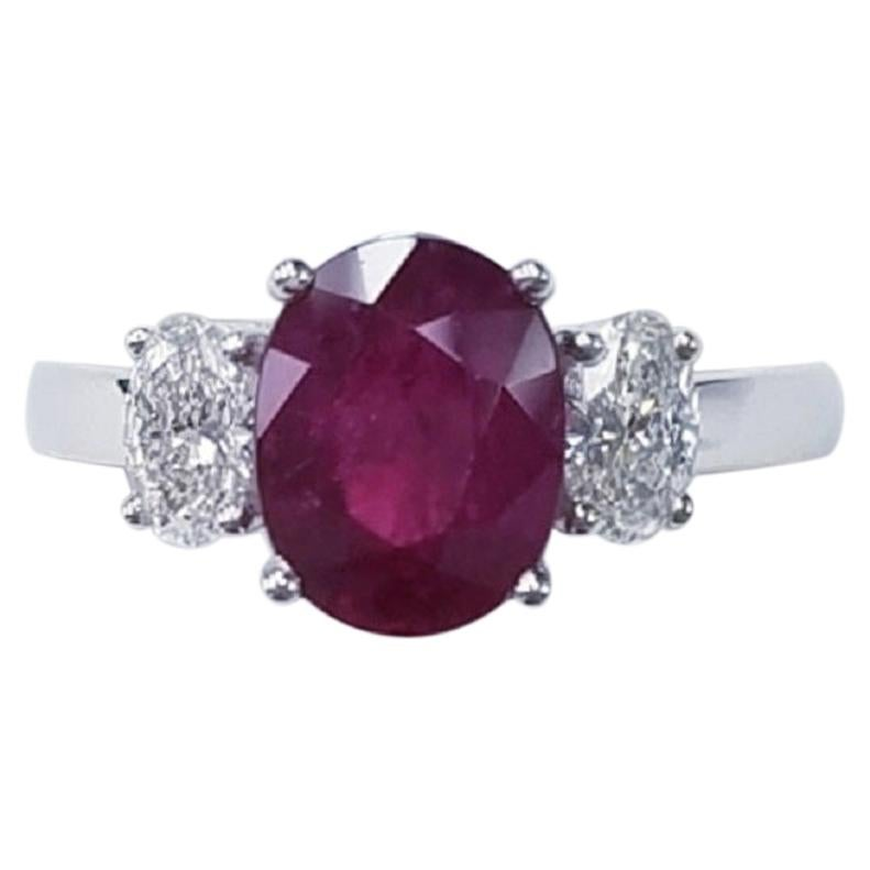 Three-Stone 18 Karat White Gold Oval Cut Ruby and Diamond Ring