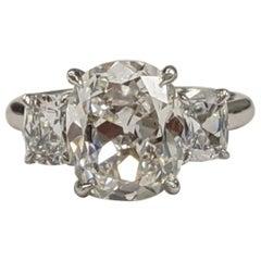 Three-Stone Cushion Diamond Ring Featuring 4 Carat G VS2 in Platinum 'GIA'