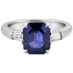 Three-Stone Diamond and Blue Sapphire Engagement Ring