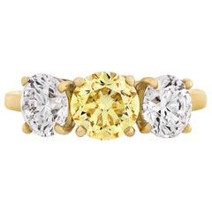 Three-Stone Fancy Vivid Yellow Diamond Ring by Cartier