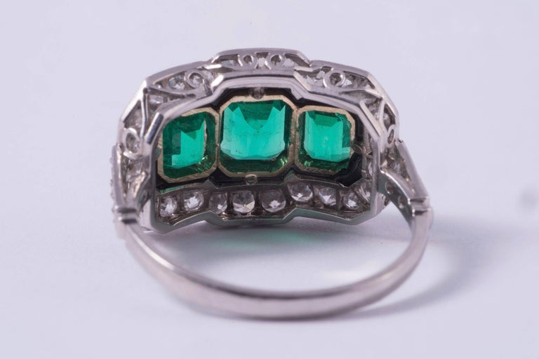 Emerald Cut Three-Stone Emerald and Diamond Ring For Sale