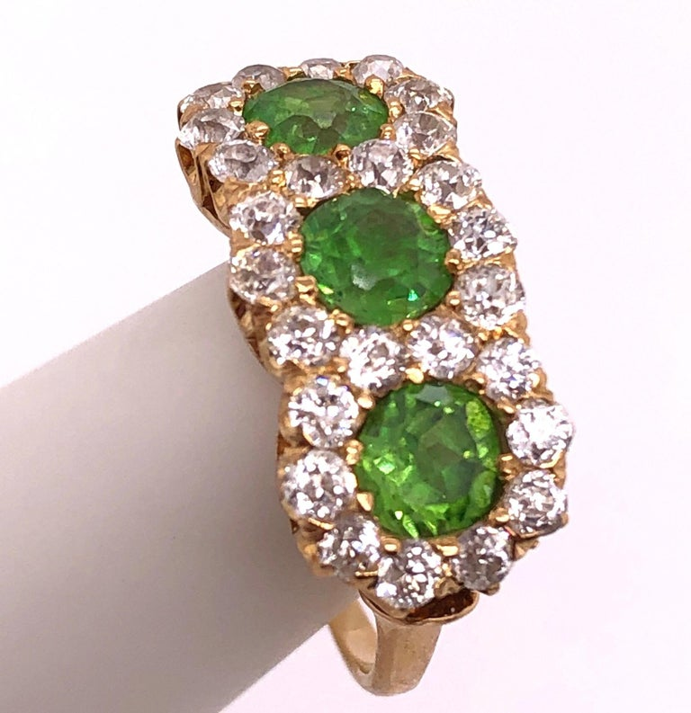 Round Cut Three-Stone Emerald and Diamond Modern Ring For Sale