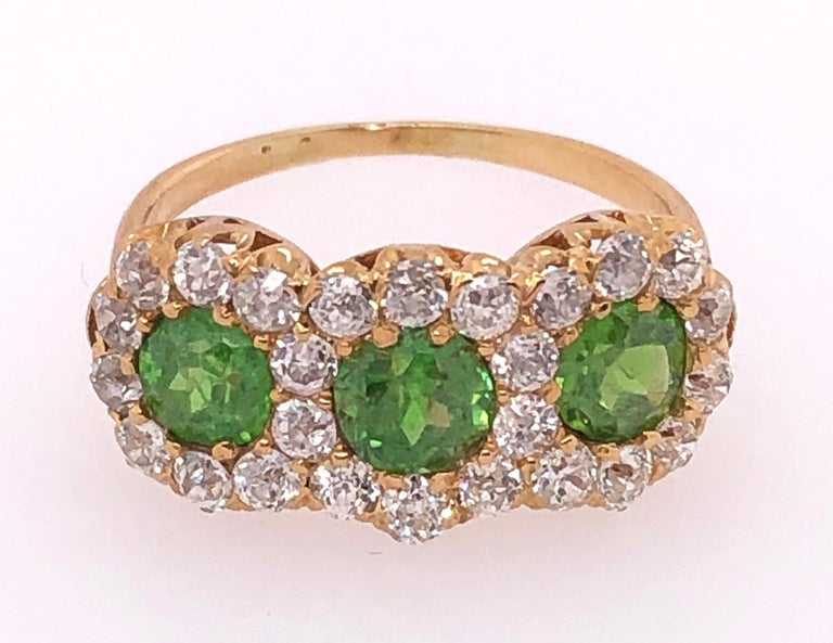 Three-Stone Emerald and Diamond Modern Ring In Good Condition For Sale In Stamford, CT