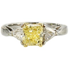 Three-Stone Fancy Yellow Diamond Engagement Ring in Platinum