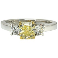 Three-Stone Fancy Yellow Radiant Cut Diamond and Round Sides Engagement Ring