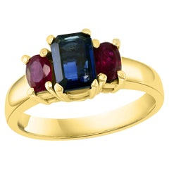 Three-Stone Natural Blue Sapphire and Ruby Engagement Ring in 14 Karat Gold
