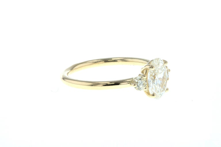 Round Cut Three-Stone Oval Diamond Engagement Ring with Round Side Diamonds 'GIA' For Sale
