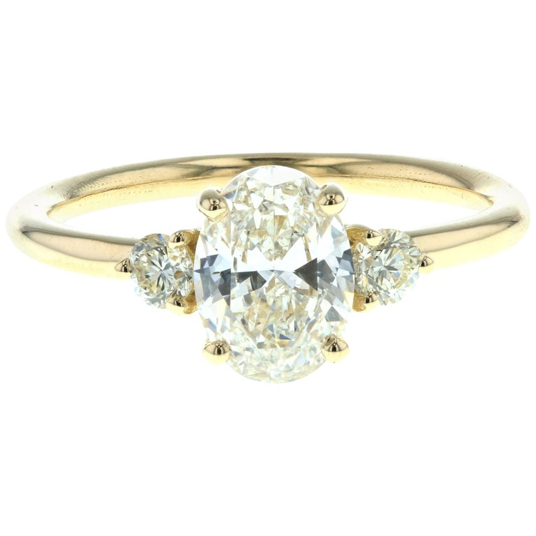 Three-Stone Oval Diamond Engagement Ring with Round Side Diamonds 'GIA' For Sale