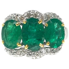 Three-Stone Oval Emerald and Diamond Ring in 18 Karat White Gold